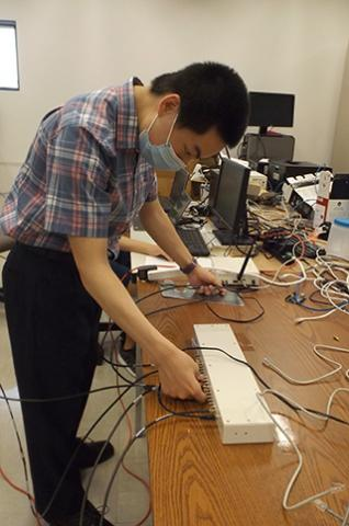 Student working with device to capture wireless signals