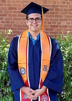 Photo of Nicolas Ramos in graduation regalia