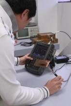 Students use Agilent tools, such as the N9923A FieldFox vector network analyzer, to measure a prototype PIFA antenna.