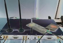"An experimental ""box"" transmitter and receiver is shown with two reconfigurable antennas similar to those in development by professors Marwan Krunz and Hao Xin."