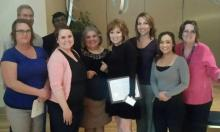 Rozanne Canizales (center) celebrates her award with members of the ECE team.