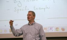 Hal Tharp leads a classroom discussion