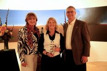 UA President Ann Weaver Hart (left) and College of Engineering dean Jeff Goldberg (right) present ECE professor Linda Powers with the i-Squared Award for Innovation and Impact at the second annual Tech Launch Arizona awards event.