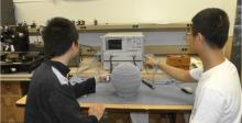 Students in Hao Xin's lab perform measurements on a 3-D printed prototype of a Lüneburg lens.