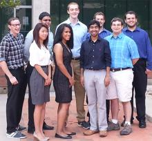 Undergraduate students from across the United States take a break from participating in this summer's REU CAT vehicle research program.