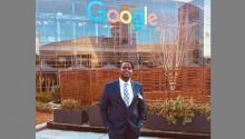 Andrew Kirima standing in front of the Google headquarters