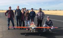 Team photo with their model airplane for the 2021 Arizona Autonomous competition
