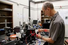 Raymond Kostuk exhibits the bench-top VHIS in his lab; image courtesy of Taylor Hudson/Tech Launch Arizona