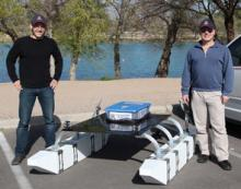 Wolfgang Fink, right, and his ECE grad student Alex Jacobs, prepare to launch TEX II for a series of tests on a lake near Tucson, Ariz.