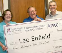 Nancy Emptage (ECE administrative associate who organized the nomination), IT manager Leo Enfield (center), and College of Engineering Dean Jeff Goldberg celebrate Leo's 2013 Billy Joe Varney Award.