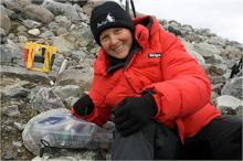UA Professor Linda Powers, shown here in the Arctic with one of her instruments, is taking her portable technology to a new level: diagnosing blood-borne disease.