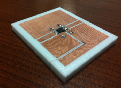 In one line of research, Hao Xin's team is developing 3-D printing solutions to the challenges of combining different materials, as in this coplanar waveguide, a device that is used to transmit microwave-frequency signals.