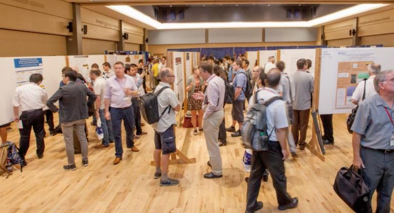 UA students mingle with researchers from around the world during a poster exhibit at the 39th annual International Conference on Infrared, Millimeter, and Terahertz Waves, held at the University of Arizona.