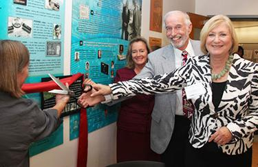 From left, Thomas R. Brown Foundation trustees Sarah Brown Smallhouse and Mary Brown Bernal, retired Burr-Brown engineer Paul Prazak, and UA President Ann Weaver Hart cut the ribbon. (UA College of Engineering photo/Pete Brown.)