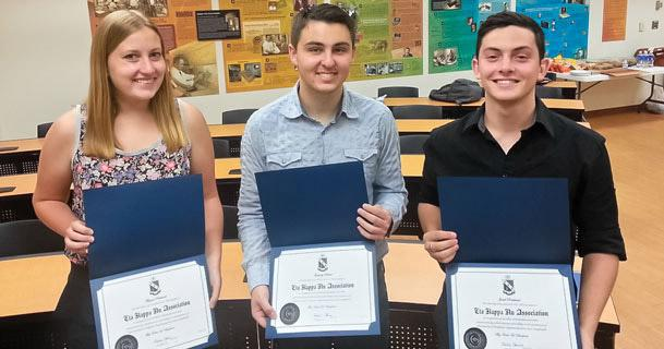 Students Megan Pritchard, Greg DePaul and Jake Rockland at their induction into Iota Xi, the UA student chapter of the Institute of Electrical and Electronics Engineers-Eta Kappa Nu.