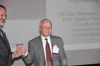 Salim Hariri accepts a UA Technology Innovation Award for his work in cybersecurity.