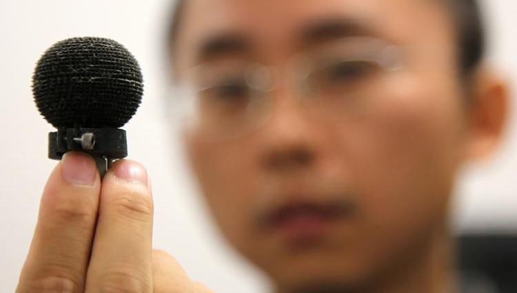 A researcher holds a sensor