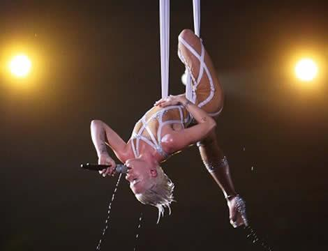 Performances like this one by singer Pink in midair at the Grammys, with special automated equipment, increasingly rely on the skills of engineers and computer experts to safely guide the acrobatics.