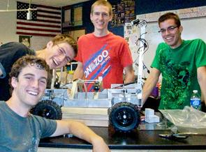 The XSV rover and some team members, from left to right: Lane Ellwood, Jesse Odle, Jordan Odle and Brandon Pitts.