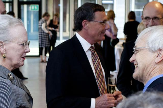 Richard Ziolkowski, right, meets Queen Margrethe II of Denmark, left, as he receives an honorary doctorate from Technical University of Denmark in 2012. (Photo courtesy of Technical University of Denmark)