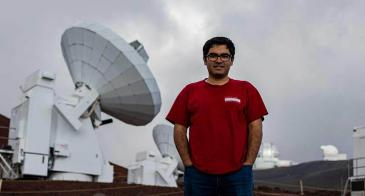 Electrical engineering doctoral student Arash Roshanineshat at the Submillimeter Array, an array of eight 6-meter telescopes in Mauna Kea, Hawaii.