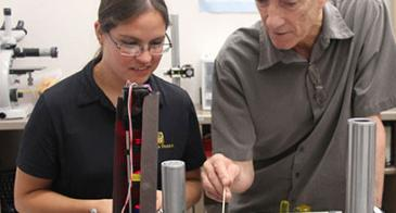 Raymond Kostuk and one of his grad students, Isela Howlett, test the new bench-top imaging instrument for ovarian cancer.